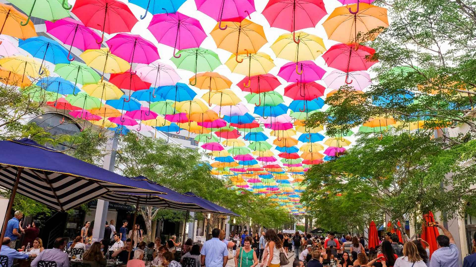 Umbrella art installation adds colorful explosion to Giralda Plaza in Coral Gables